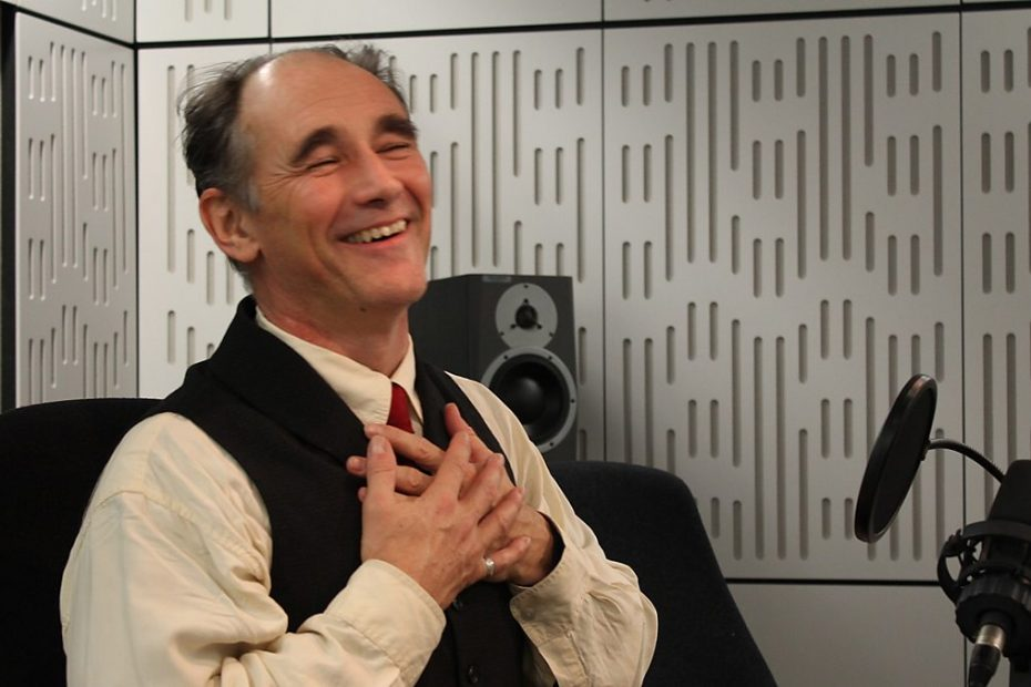 Mark Rylance beaming and holding his hands to his heart